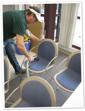 Bob Green cleaning a chair